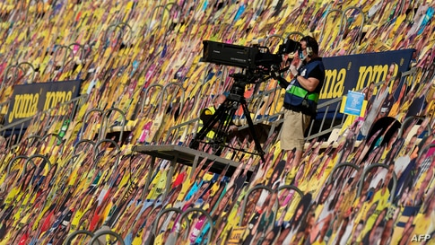 A cameraman works among cardboards of fans prior to the Spanish League football match Villarreal CF against Sevilla FC at La Ceramica stadium in Vila-real, Spain, June 22, 2020.