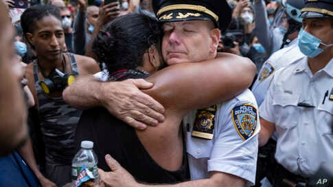 Chief of Department of the New York City Police, Terence Monahan, hugs an activist, June 1, 2020, during a protest the death of George Floyd.