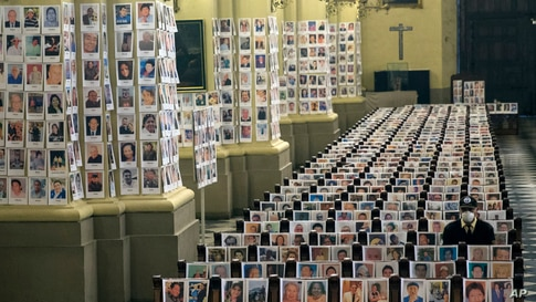 Portraits of people who died of the COVID-19, are seen inside the Cathedral, in Lima, Peru, June 13, 2020.