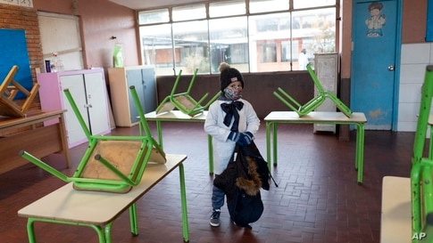 A student enters his public school classroom for the first time in three months since the lockdown to curb the spread of the new coronavirus pandemic in Montevideo, Uruguay.