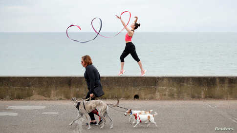 Team GB Rhythmic Gymnast Lynne Karina Hutchison is seen during a training session on the seafront in Hove, Britain.
