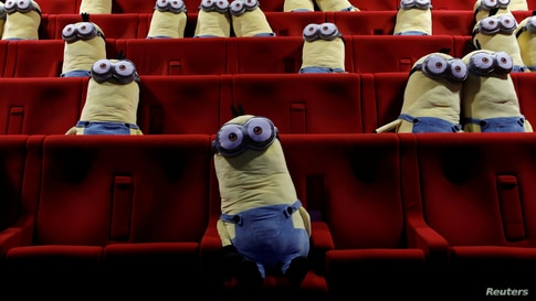 Minions toys are seen on cinema chairs to maintain social distancing between spectators at a MK2 cinema in Paris as cinemas reopen doors to the public following the coronavirus disease (COVID-19) outbreak in France.