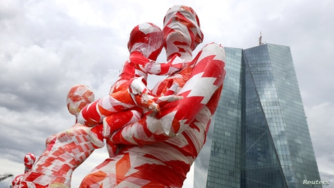 """A partially incomplete display of mannequins wrapped in a barrier tape as part of the art installation """"It is like it is"""" by German art student Dennis Josef Meseg, is seen in front of the European Central Bank headquarters in Frankfurt, Germany."""