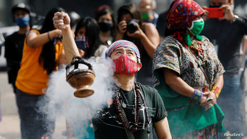 Mayan indigenous people take part in a ceremony in memory of Domingo Choc, a 56-year-old practitioner of traditional Maya medicine who was set ablaze by a mob accusing him of witchcraft, at the Parque Central in Guatemala City, Guatemala, June 10, 2020.