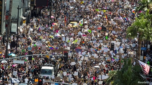 People take part in an All Black Lives Matter march, organized by Black LGBTQ+ leaders, in the aftermath of the death in Minneapolis police custody of George Floyd, in Hollywood, Los Angeles, California, June 14, 2020.