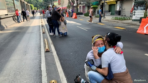 People react during an earthquake in Mexico City, Mexico.