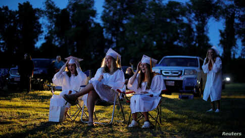 Seniors watch a video retrospective of their time in high school during Pioneer Valley Regional School's graduation, which was held in the Northfield Drive-In Theater because of the COVID-19 outbreak in Hinsdale, New Hampshire, June 8, 2020.