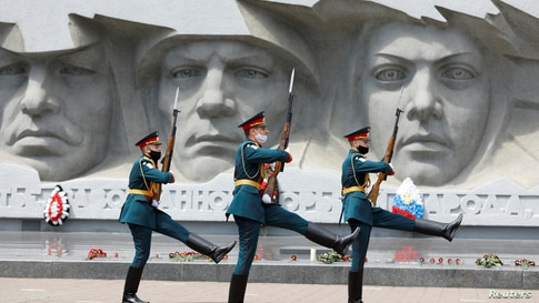 Honor guards march near a World War II monument in Stavropol, Russia, on the anniversary of the beginning of the Great Patriotic War against Nazi Germany in 1941.