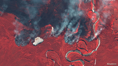 Smoke rises from wildfires near Berezovka River in Russia in this June 23, 2020 color infrared image supplied by Maxar Technologies.