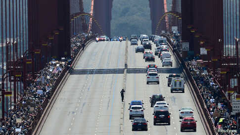 Thousands of demonstrators march across the Golden Gate Bridge during a protest against racial inequality in San Francisco, California, June 6, 2020.