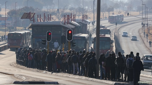 Buses are seen as stranded commuters wait for transportation at a bus terminal during a protest by taxi operators over the government's financial relief for the taxi industry, amid the coronavirus disease (COVID-19) lockdown, in Soweto, South Africa.