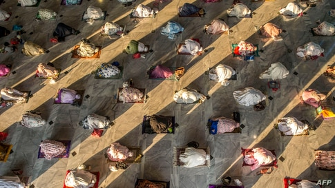 Muslims attend Eid al-Adha prayers with social distancing as a preventive measure against the COVID-19 coronavirus at a mosque…
