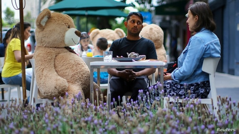 Teddy bears are located on the tables to maintain social distancing measures at Jaso Bakery restaurant during the start of the…