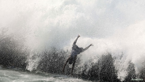 A Somali boy dives to swim near a reef at the Geelaq beach in the Indian Ocean, amid the potential spread of coronavirus…