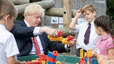 Britain's Prime Minister Boris Johnson reacts during his visit The Discovery School in Kings Hill, south east England.