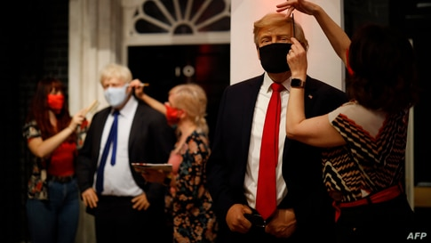 Artists put the finishing touches to wax figures of U.S. President Donald Trump and Britain's Prime Minister Boris Johnson as Madame Tussauds in London, prepares to reopen its doors to the public.