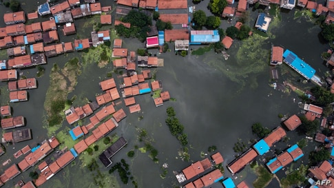 An aerial view shows flooded residential buildings due to rising water levels of the Yangtze river in Jiujiang, China's central Jiangxi province, July 18, 2020.