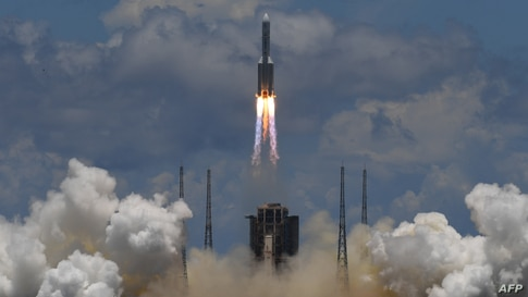 A Long March-5 rocket, carrying an orbiter, lander and rover as part of the Tianwen-1 mission to Mars, lifts off from the Wenchang Space Launch Centre in southern China's Hainan Province.