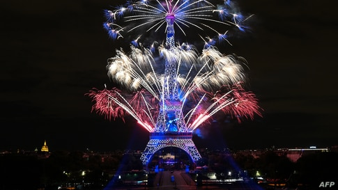 Fireworks explode above the Eiffel Tower as part of the annual Bastille Day celebrations in Paris, France, July 14, 2020.