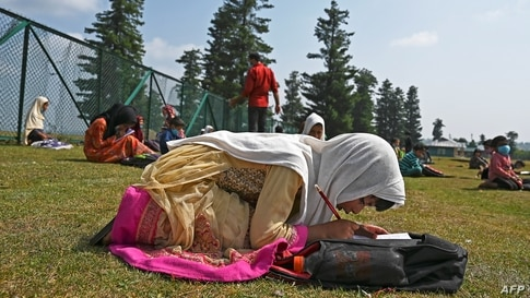 Students attend an open-air school situated on top of a mountain in Doodhpathri, Indian-administered Kashmir, on July 27, 2020.
