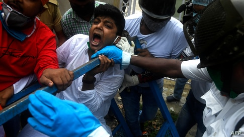 Activists of Congress Party shout slogans against the Bharatiya Janata Party (BJP) led central government and state Governors as they try to break police barricades in front of the Raj Bhavan (Governor's House) in Kolkata, India.