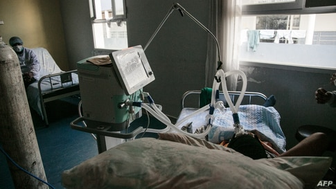 A patient severely infected with COVID-19, is on life support at the Andohatapenaka University Hospital in Antananarivo, Madagascar.