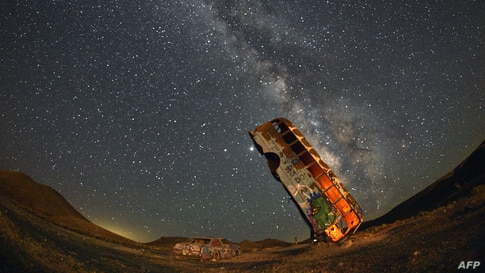 The Milky Way galaxy is seen in the sky above the International Car Forest of the Last Church in Goldfield, Nevada, July 18, 2020.