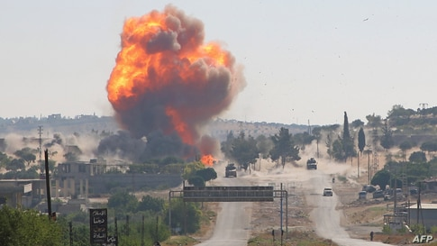 A fireball erupts from the site of an explosion reportedly targeting a joint Turkis-Russian patrol on the strategic M4 highway, near the Syrian town of Ariha in the rebel-held northwestern Idlib province.