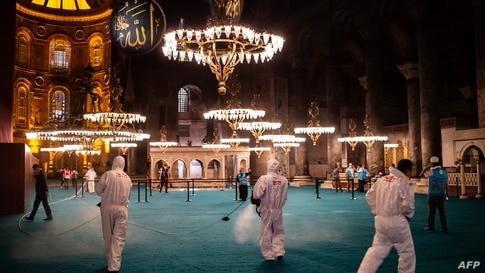 Fatih Municipality workers disinfect the interior of Hagia Sophia mosque after the night prayer in Istanbul, Turkey, July 26, 2020.