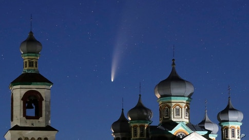 The comet Neowise or C/2020 F3 is seen behind an Orthodox church over the Turets, Belarus, 110 kilometers (69 miles) west of capital Minsk.