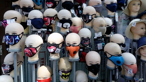 Masks placed on mannequins heads are displayed outside a shop in Sarajevo's main street, Bosnia.