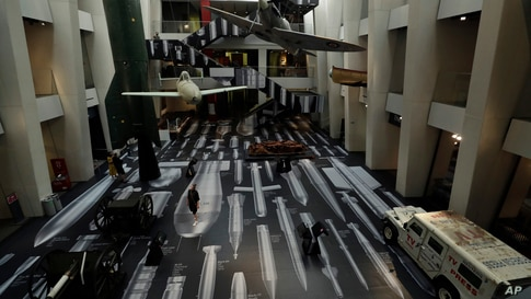 """Art installation by Chinese artist Ai Weiwei entitled """"History of Bombs""""is seen covering the floor and a staircase in the Atrium at the Imperial War Museum in London."""