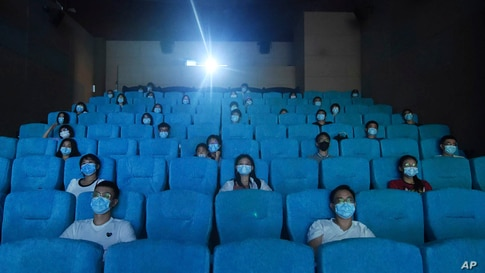 Movie-goers are spaced apart as they watch a movie in a newly reopened cinema in Hangzhou in eastern China's Zhejiang province.