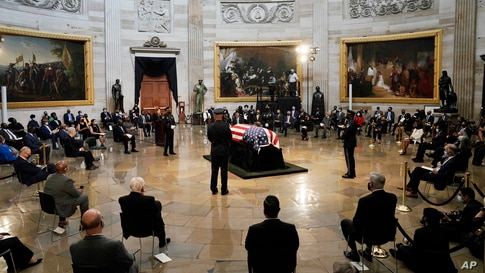 The flag-draped casket of the late Rep. John Lewis, D-Ga., a key figure in the civil rights movement and a 17-term congressman, lies in state, July 27, 2020, at the Capitol in Washington, D.C.