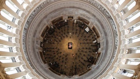 The flag-draped casket of civil rights pioneer Rep. John Lewis, D-Ga., is placed by a U.S. military honor guard at the center of the U.S. Capitol Rotunda to lie in state in Washington, D.C., July 27, 2020.