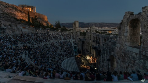 Actors and singers perform at the Odeon of Herodes Atticus in Athens, Greece, after the site was reopened for performances, July 15, 2020.