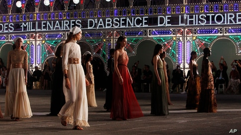 Models wear creations during the unveiling of the Dior 2021 cruise collection in Lecce, southern Italy, July 22, 2020.