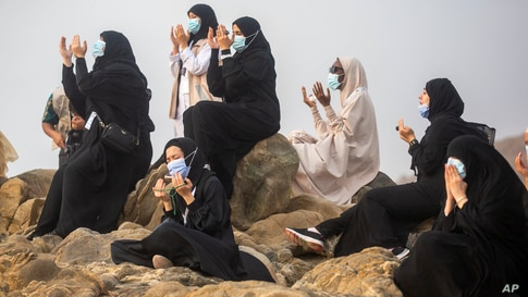 Muslim pilgrims pray on top of the rocky hill known as Mountain of Mercy on the Plain of Arafat during the annual hajj pilgrimage near the holy city of Mecca, Saudi Arabia.
