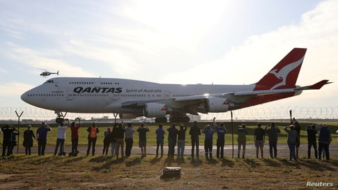 People watch the last Qantas 747 jet depart Sydney Airport in Sydney, Australia, as Qantas retires its remaining Boeing 747 planes early due to the coronavirus disease (COVID-19) outbreak.