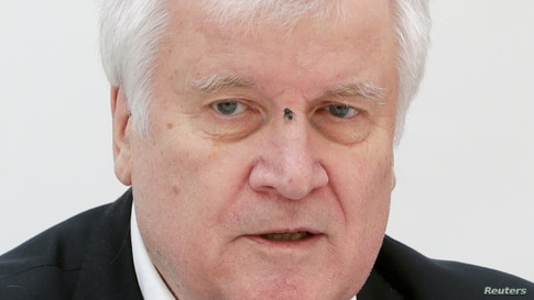 A fly is seen on German Interior Minister Horst Seehofer's face as he speaks during a joint news conference with Austrian Interior Minister Karl Nehammer (not pictured) in Vienna, Austria.
