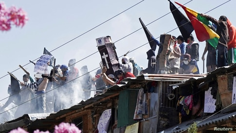Inmates protest on the rooftop of the San Sebastian prison, to demand government medical assistance, amid the coronavirus disease (COVID-19) outbreak, in Cochabamba, Bolivia, July 27, 2020.