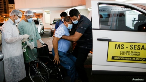 Yawalapiti chief Aritana, suffering from the coronavirus disease (COVID-19), is supported by the doctor Celso Correia Batista outside the Sao Francisco de Assis hospitalin Goiania, Brazil, July 22, 2020.