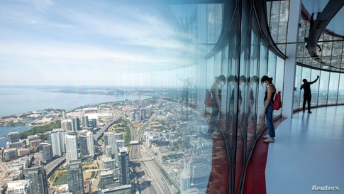 Visitors view panoramic city scenes from the 553 metres (1815 feet) high CN Tower, which reopened for the first time since the coronavirus disease (COVID-19) restrictions were imposed in Toronto, Ontario, Canada, July 15, 2020.