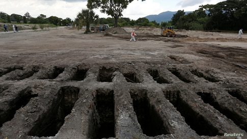 Recently dug graves are seen at an area for victims of the coronavirus disease (COVID-19) at La Bermeja cemetery, as the coronavirus disease outbreak continues in San Salvador, El Salvador, July 21, 2020.