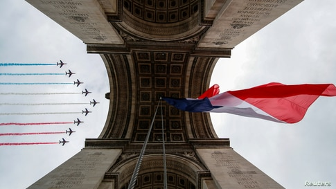 Alpha jets from the French Air Force Patrouille de France fly over the Arc de Triomphe during the Bastille Day celebrations in Paris.