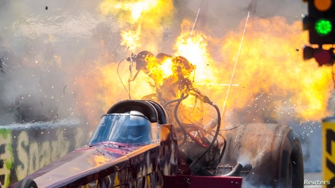 NHRA top fuel driver Kyle Wurtzel explodes an engine on fire during qualifying for the E3 Spark Plugs Nationals at Lucas Oil Raceway in Clemont, Indiana, July 11, 2020. (Credit:Mark J. Rebilas/USA TODAY Sports)