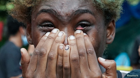 "A woman cries as she watches people being detained on the Brooklyn Bridge just outside the ""City Hall Autonomous Zone"" in support of ""Black Lives Matter"" in the Manhattan Borough of New York City."