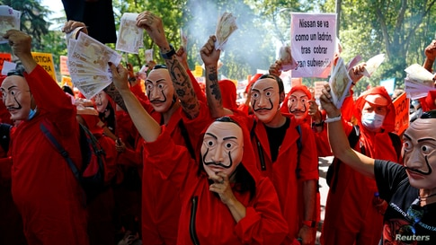 "Nissan workers dressed in costumes from ""La Casa de Papel (Money Heist)"" take part in a protest outside Spanish parliament in Madrid."