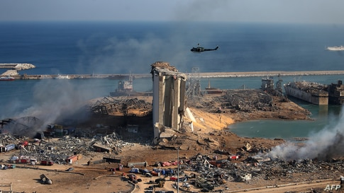 A general view shows the damaged grain silos of Beirut's harbour and its surroundings on August 5, 2020, one day after a…