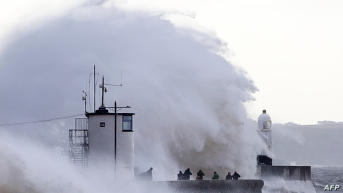 Waves crash against the sea wall at Porthcawl, south Wales, on August 21, 2020 as Storm Ellen brings high winds across the…